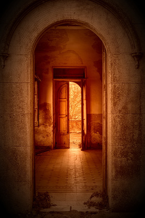 old door and sun flare in perspective view Stock Photo