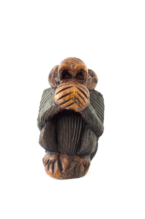 critique: wood sculpture of speak no evil monkey on white background Stock Photo