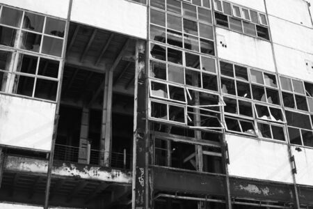 Destroyed facade of an old, abandoned factory