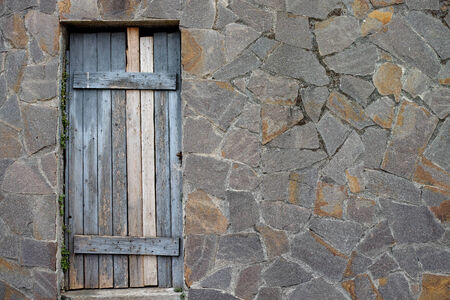 rustic door and stone wall