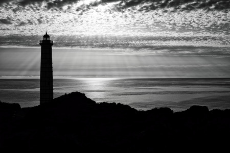 lighthouse silhouette in black and white