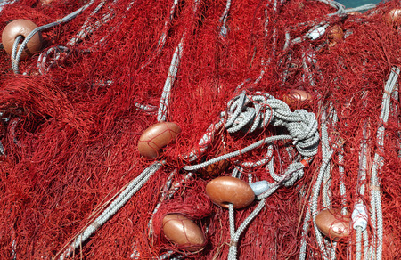 red fishing net with floats and rope Stock Photo