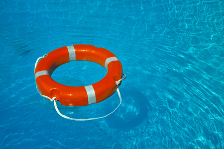 float lifesaver on blue water