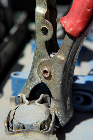 car battery red cable with tongs
