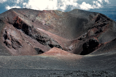 Crater in Mount Etna with red details Stock Photo