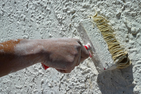 painting a wall with a big brush Stock Photo