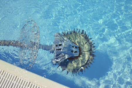 Swimming pool cleaner robot immersed in water
