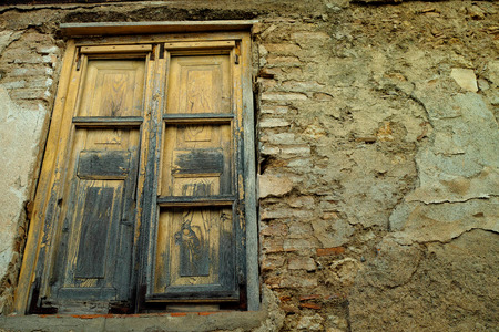 rustic old wood window on rough wall in perspective view