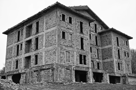 ghostly  and spectral abandoned building in black and white