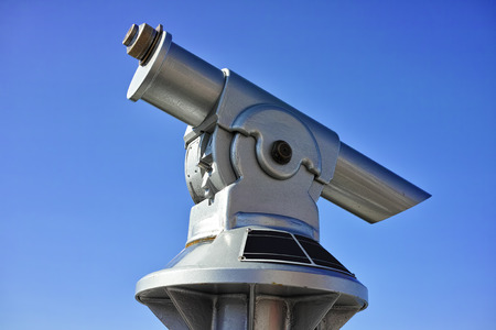 Touristic scope with blue sky backgroud