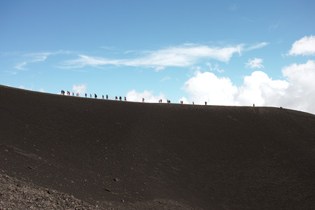 People walk in high mountain. Location: Mount Etna Stock Photo