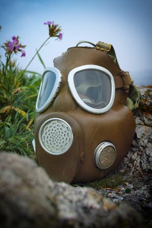 Old Gas mask on rocks