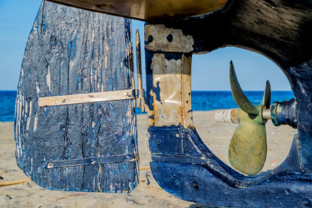 rudder and propeller of a blue boat