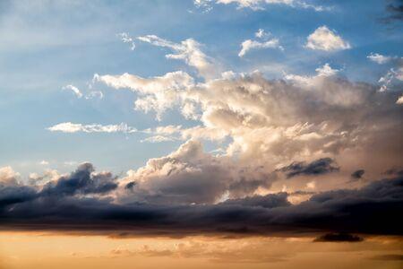 clouds in blue and orange sky