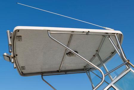 Rigid boat canopy in fiberglass and aluminum with antenna