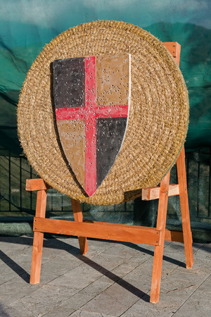 Medieval archery target with old banner with holes made by arrows Stock Photo - 36202682