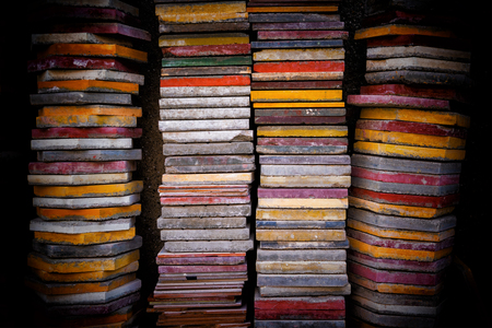 Multicolored tiles stacked ready to use
