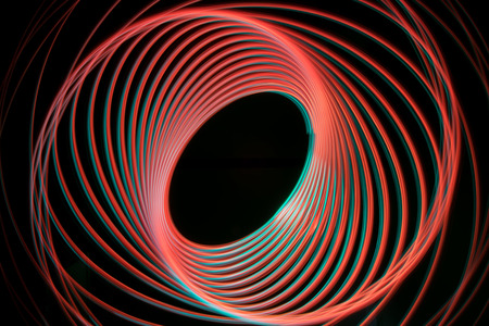 Red and green light effect spiral with two arms Stock Photo