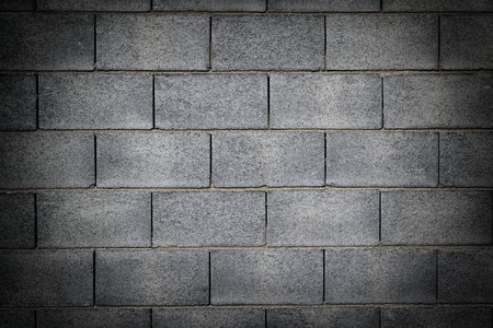 Background of a wall made in cement bricks with dark vignetting Stock Photo