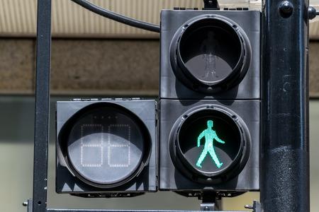 pedestrian: GREEN pedestrian traffic lights under sunlight Stock Photo