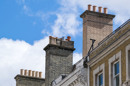 ancient chimneys pot in perspective view under sunlight Stock Photo