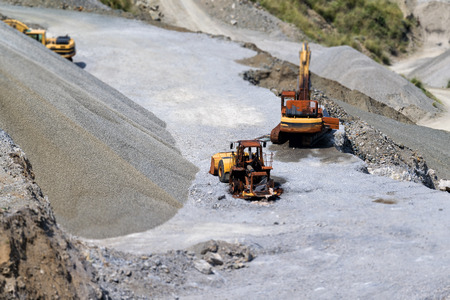 quarry and bulldozers with tilt shift effect