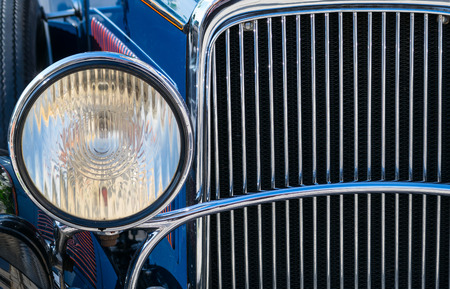 the detail: Detail of chromed plated old car front light and radiator