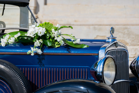 White flowers bouquet on a old car in a wedding day Stock Photo - 47920024