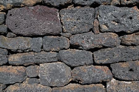 Wall made of volcanic bricks in Sicily, Italy. Stock Photo