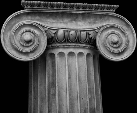 Ionic Capital crop on black background