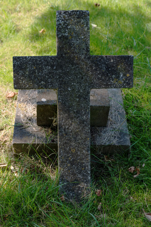 Old stone cross on grass ground Stock Photo - 85099475