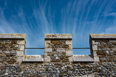 Merlons of a medieval castle under a blue and cloudy sky Stock Photo - 85430264