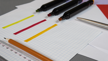 Open Colored Felt Tip Pens lie on the open notebook. Stationery for schoolchild or student