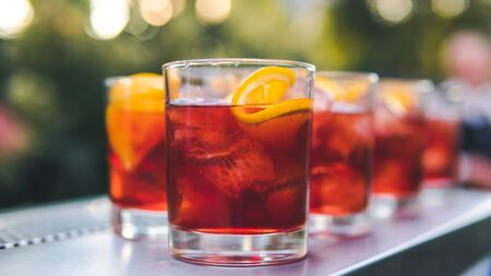 Close-up of colorful exotic cocktail stand on the bar, outdoors. Concept about drink, alcohol and restaurant service, catering Stock Photo