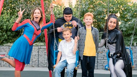09/05/2019, Kyiv, Ukraine: Actors in suits of Spiderman and Batman working at the Birthday party for little children. Children play with animators, outdoors Éditoriale