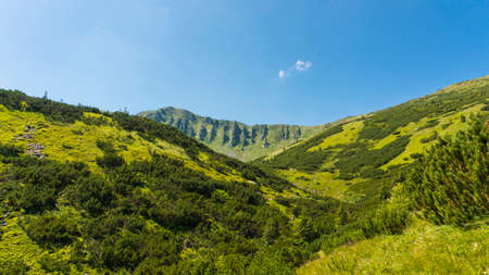 Amazing mountain landscape with blue sky with white clouds, sunny summer day in Carpathians, Ukraine. Natural outdoor travel background. Foto de archivo