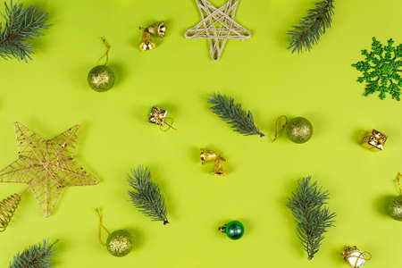 Fir tree branches and Christmas decorations on green background. Concept of New Year presents, festive and holiday shopping Фото со стока