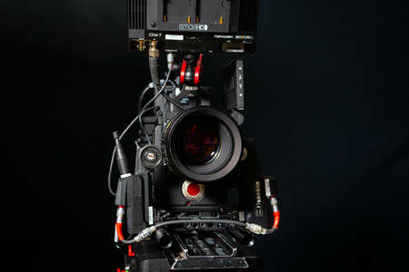 Kyiv, Ukraine - 04.17.2020: Studio shoot of professional 5k video camera Red DSMC2 with lens Leica Zerooptik Summilux-r 80, close-up. Professional equipment for cinematographer, movie technology 新闻类图片