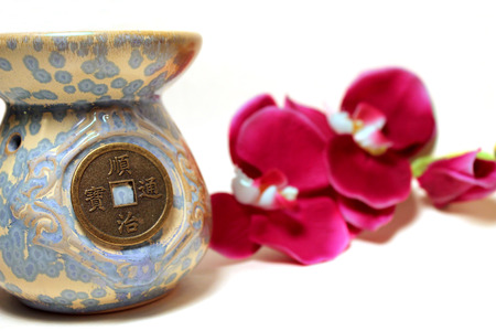 Blue Old Feng Shui Chinese Vase With Coin On White Background