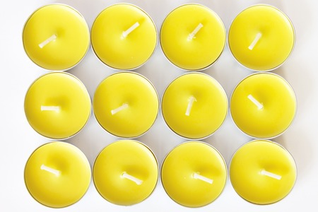 Set of yellow unlit new tea candles, top view Stock Photo