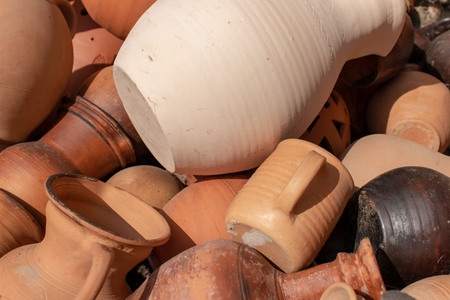 Many ceramic handmade utensils, made of clay, close up Stock Photo