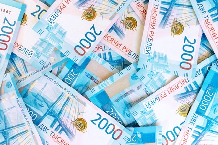 Background Of Paper Russian Money. New Russian Banknotes Of 2000 Two Thousands Rubles Stock Photo