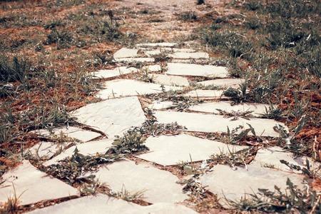 Old stone road, close up stone slab.