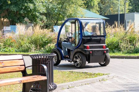 MOSCOW, RUSSIA - SEPTEMBER 02, 2018: People driving electric car in park. Reklamní fotografie - 133071339