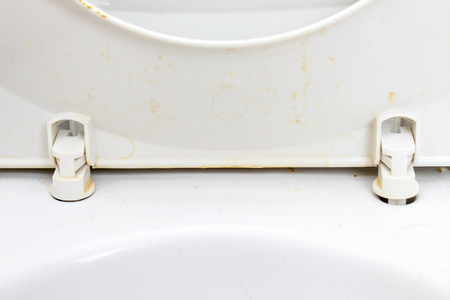 Dirty unhygienic toilet seat close up at public restroom - household and bathroom cleaning concept. Banco de Imagens