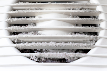 Extremely dirty and dusty white plastic ventilation air grille at home close up, harmful for health.