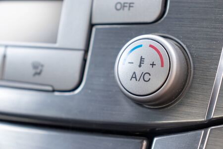 Temperature control knob in car air conditioning system close up, comfort and fresh air in vehicle cabin.