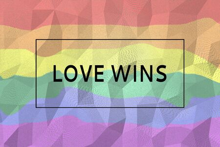 Digitally generated sign with tag love wins on lgbt rainbow colored background. Stock Photo