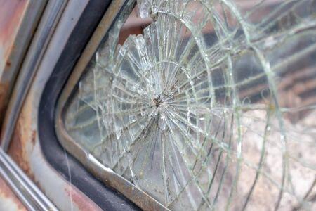 Broken glass window of an old rusty car. Stok Fotoğraf