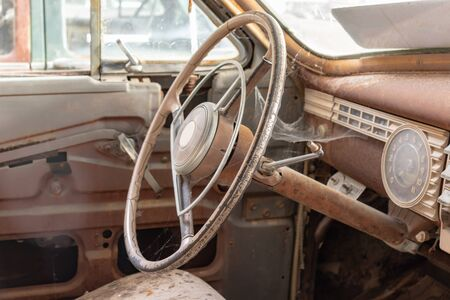 Steering wheel of an old abandoned rusty car.